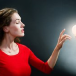 Woman with Bright Idea Lightbulb